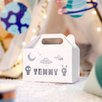 white large gable gift box with tommy written on the side, also on the side is cartoon drawings of aliens and UFO's, this is printed in metallic silver