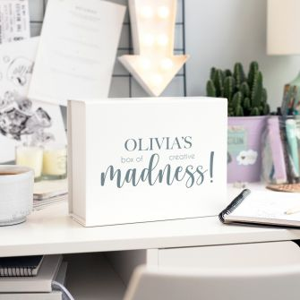 Creative madness box on a crafters desk